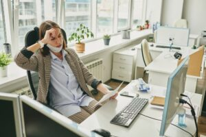 Frustrated woman in empty office